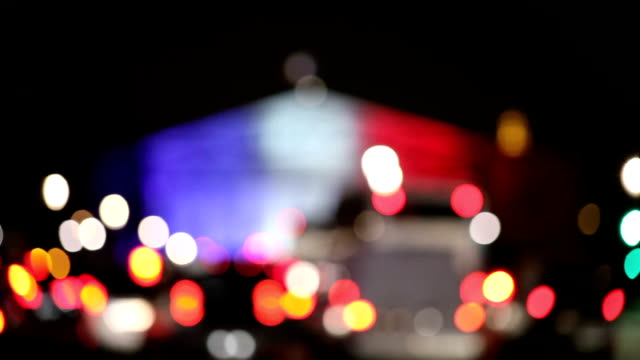 Blurry View on French Parliament with cars lights and Bokeh video