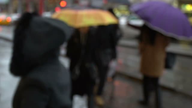 Blurry Women are Walking in Slow Motion at Street with Colorful Umbrellas at Istanbul Kadikoy video