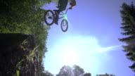 SLOW MOTION: Bmx biker jumps over the sun video