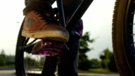 SLOW MOTION CLOSE UP: Bmx biker playing with bike pedal in sunny evening video