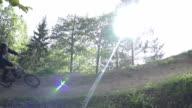 SLOW MOTION: Bmx biker riding in dirt park video