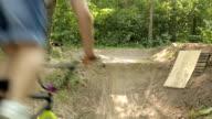 Bmx biker riding in forest video