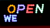 HD:LED board with 'OPEN WELCOME' word. video