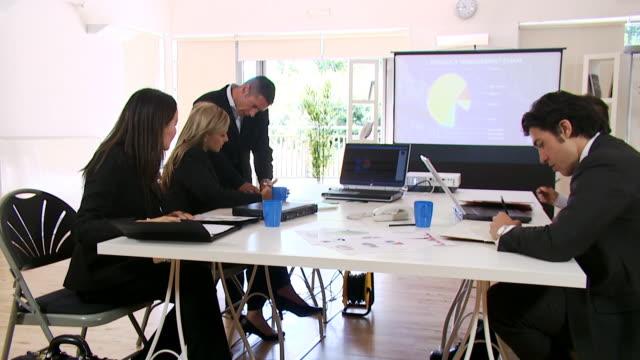 Boardroom office staff in financial meeting video