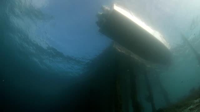 Boat calls at a small pier video