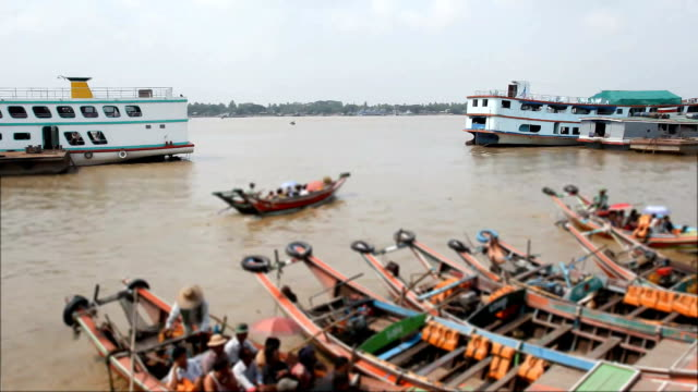 boat full of passengers out of the busy Yangon port video