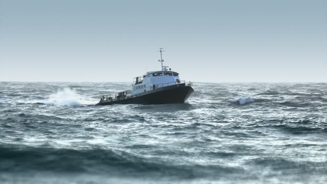 Boat in Rough Seas - Heading to Port video