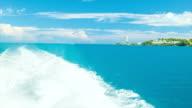 Boat Leaving Wake in Ocean near Tropical Island video