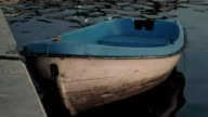 Boat on the water at the quay moorage at sunset video