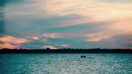 Boat rides on the river or lake at dawn video