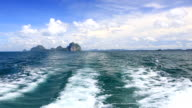 Boat riding at Andaman sea with island background video