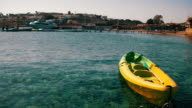 Boat Tied to a Pier in the Red Sea on the Beach Background video