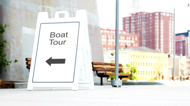 Boat Tours foldout sign in downtown metropolitan area during daylight video
