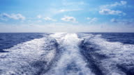 Boat wake boating fast on blue Mediterranean video