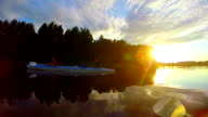 Boating on river at sunset, people having rest after rowing video
