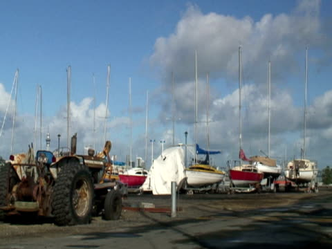 Boats and Tractor in Boat Yard / Marina video