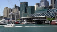Boats arriving and leaving darling harbour in Sydney video