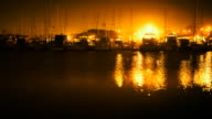 Boats in Harbor At night video
