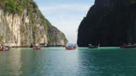 Boats in the fantastic landscape of the island of phiphi-lei. Maya bay video