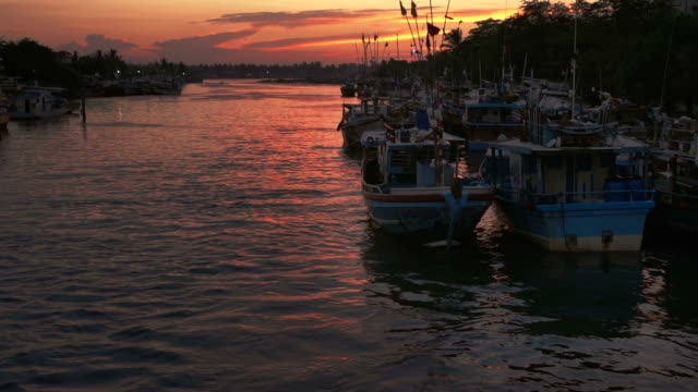 boats on a river at sunset in Sri Lanka video