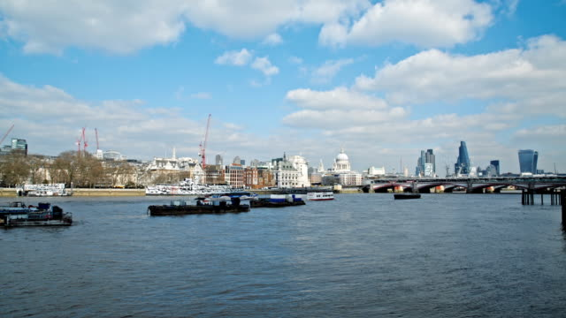 Boats on River thames and skyline of London video