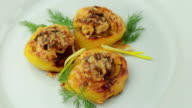 Boats potato stuffed with beef meat and hard parmesan. video