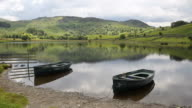 Boats Watendlath Tarn Lake District Cumbria England uk video
