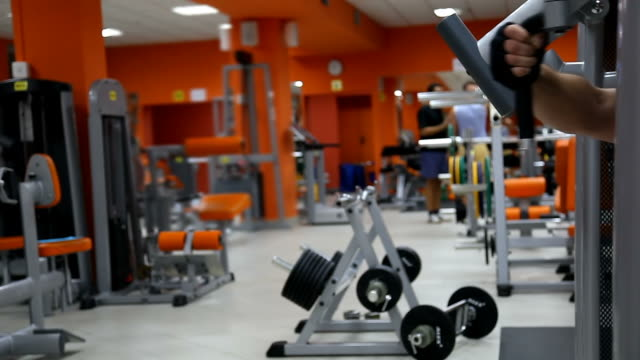 Body builders in fitness club. Background video