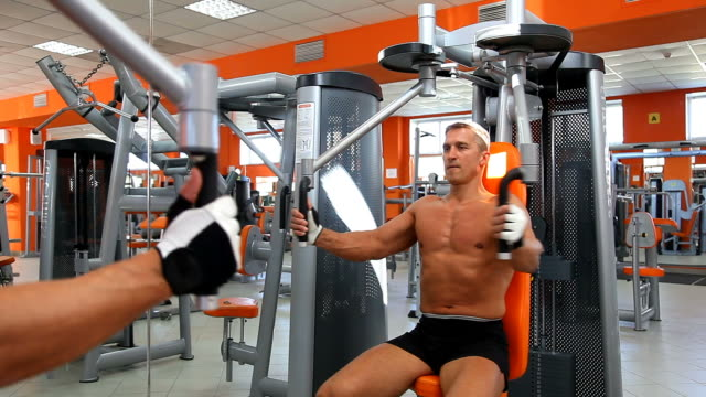 Body builder's workout on Butterfly video