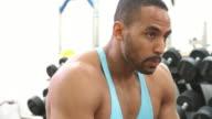 Bodybuilder drinking water at a gym video