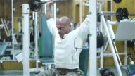 bodybuilder exercising pectoral at gym video