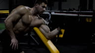 Bodybuilder exercising with weights video