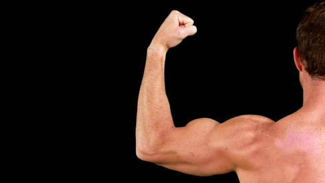 Bodybuilder posing for the camera video