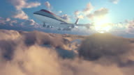 Boeing airplane above clouds at sunset video