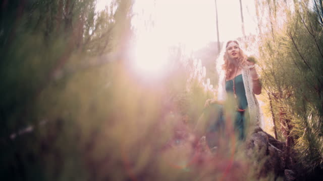 Boho girl surrounded by nature in springtime video