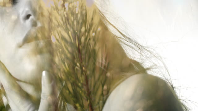 Boho girl's face with pine tree background video