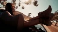Boho style teenage girl lovers enjoys a summer  road trip video