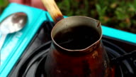 Boiled Coffee Praparing in Vintage Bronze Turka at outdoors video