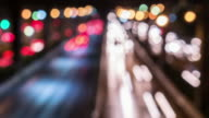 Bokeh circle light blurred time-lapse Long Exposure of road at night time in the central city , Time-lapse movement , 4k(UHD) video