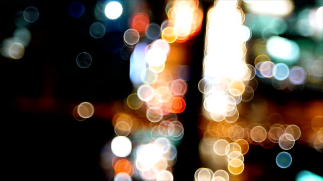 Bokeh of running car on road and city on night video