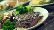 Bone in rib-eye steak being cut. video