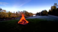 A bonfire on a grassy yard in Lahemaa park video