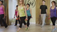 Bootcamp type group workout in a exercise studio video