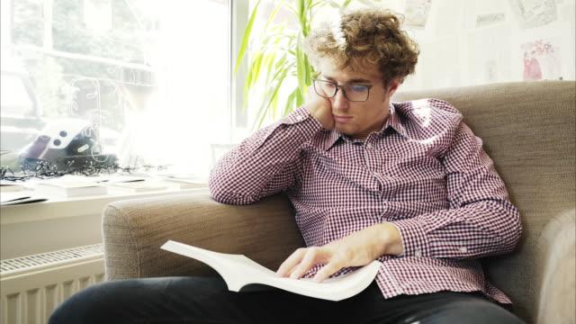 Bored men reading a book. video