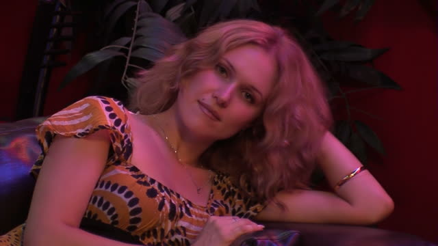 Bored woman on couch in the night club video