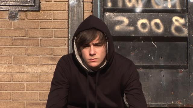 Bored Youth / Hoody Staring at camera with Graffiti video