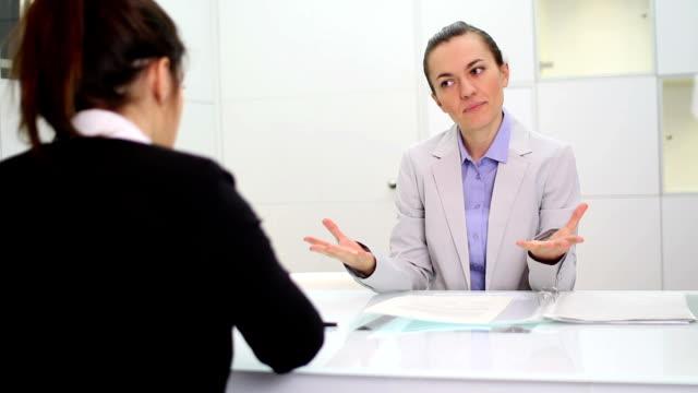 Boss communicate bad news to female worker video