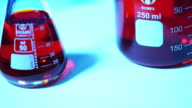 bottles of various shapes and colors on a turntable. video