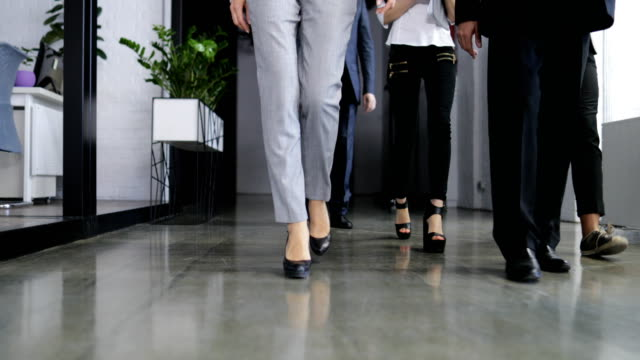 Bottom View Of Successful Team Of Business People Walking Through Modern Coworking Space Office Together video