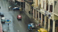 Boulevard in Havana with people and classic cars video